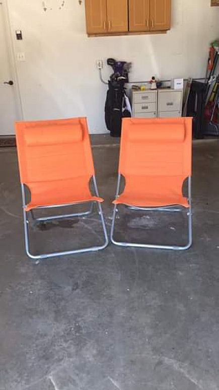 ad two folding metal and canvas chairs