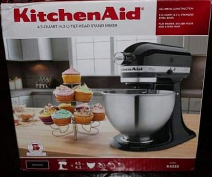 ad one black and one silver kitchen aid mixer