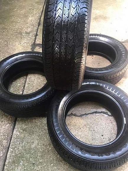ad set of 4 tires 225/60/16 less then 500 miles on them ! firestone touring pick up plano today