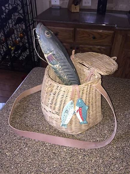 ad wicker fishing basket with wooden fish