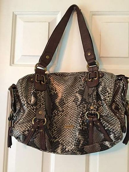 ad brown snakeskin medium size handbag.