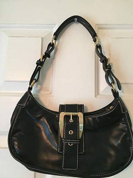 ad black leather handbag with gold details