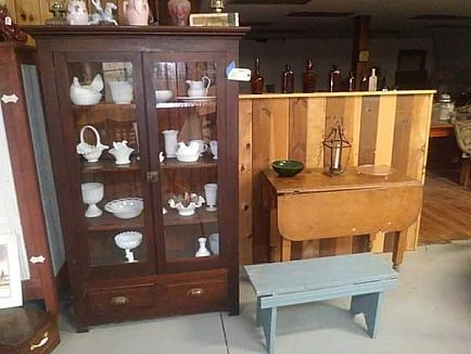 ad tables, mirrors, sleds, wagon, all sorts of antiques and vintage items