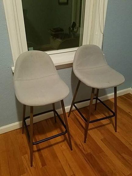 ad 2 grey counter height chairs