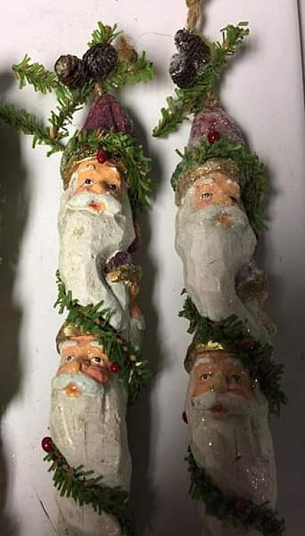 ad hand painted, hand carved painted santa decorations: with brass bells at the bottom