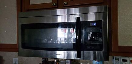 ad samsung smh1622 over the range microwave