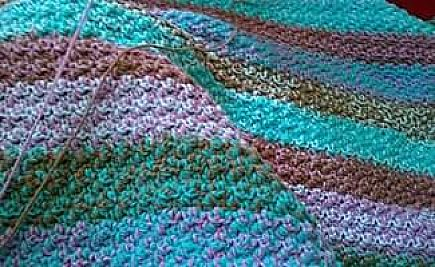 ad warm,hand crocheted afghan. machine washable and dryer friendly