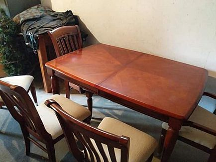 ad dining room table and chairs. higher end stuff