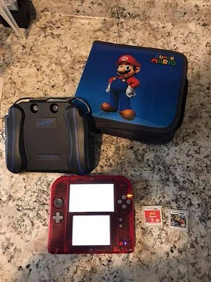 ad nintendo 2ds transparent red with case and games