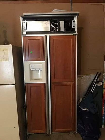 ad ge monogram refrigerator freezer w ice maker and water dispenser. huge. 36 wide by 80 high.