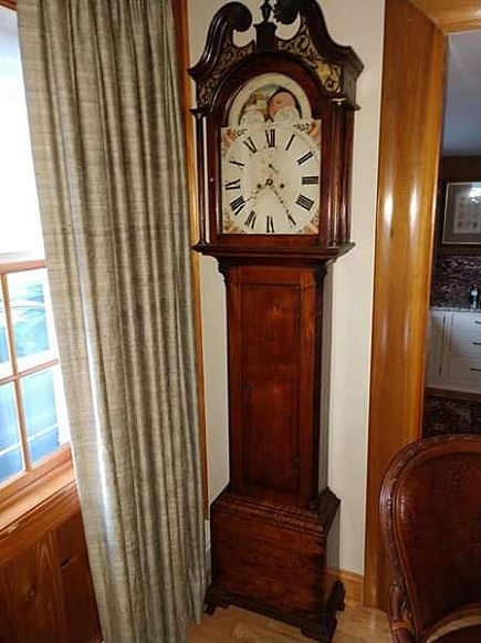 ad antique grandfather clock