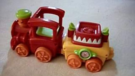 ad fisher price circus engine with attached bolted second car no animals.lights up ,moves and plays cir