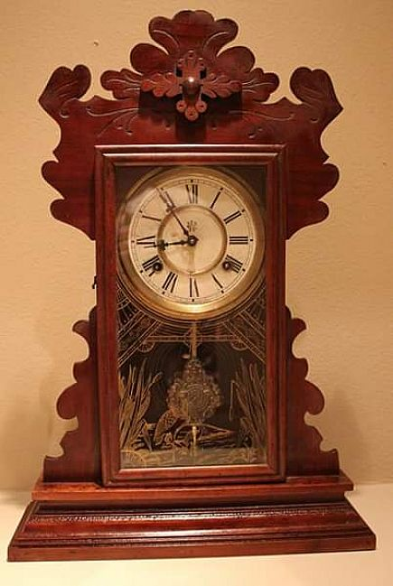 ad waterbury antique clock - early 1900's