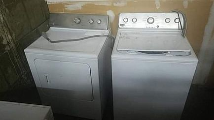 ad washer dryer a futon and a glass top long patio table