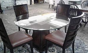 ad glass top dinette with 4 matching chairs